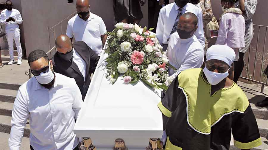 Pall bearers carry Lydia Nunez's coffin after she  died of Covid-19 in Los Angeles