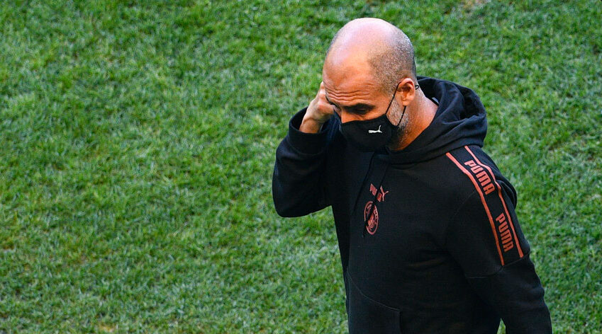 Manchester City's head coach Pep Guardiola walks on the pitch of the Jose Alvalade stadium in Lisbon on Friday.