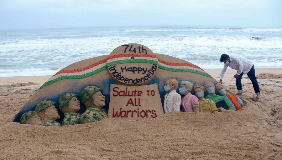 Sand artist Sudarsan Pattnaik creates a sand sculpture with message Salute to All Warriors on the eve of 74th Independence Day, at Puri beach.