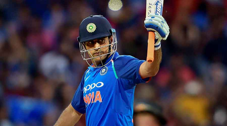 In this Sept. 17, 2017 file photo former Indian cricket captain MS Dhoni celebrates his half-century during the first India-Australia ODI cricket match at the M A Chidambaram Stadium, Chennai.
