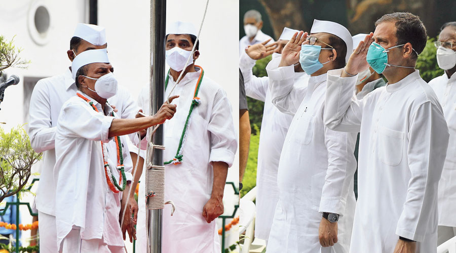 Rahul Gandhi and other Congress leaders salute as party senior AK Antony hoists the Tricolor during the Independence Day celebrations at the AICC headquarters in New Delhi on Saturday.
