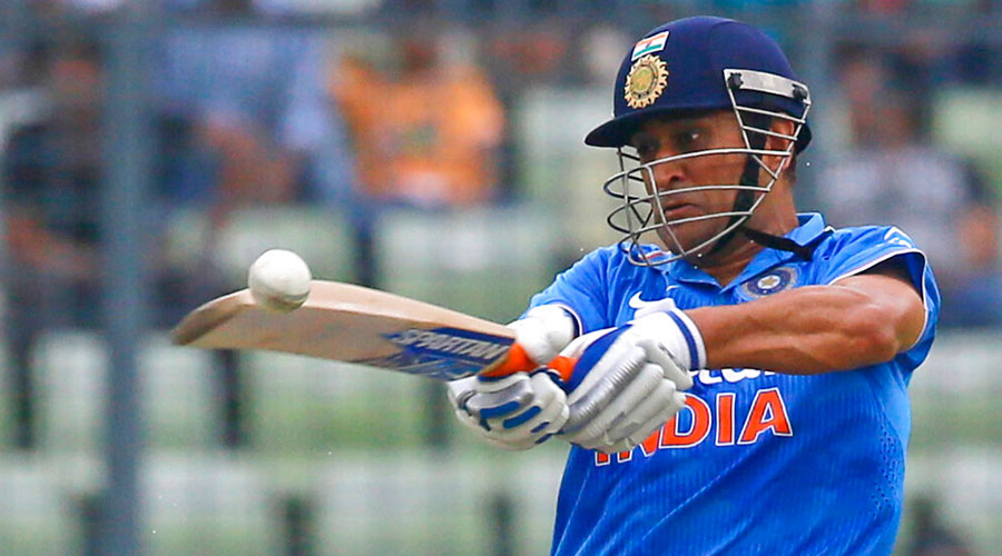 Mahendra Singh Dhoni plays a shot during in Dhaka on June 24, 2015.