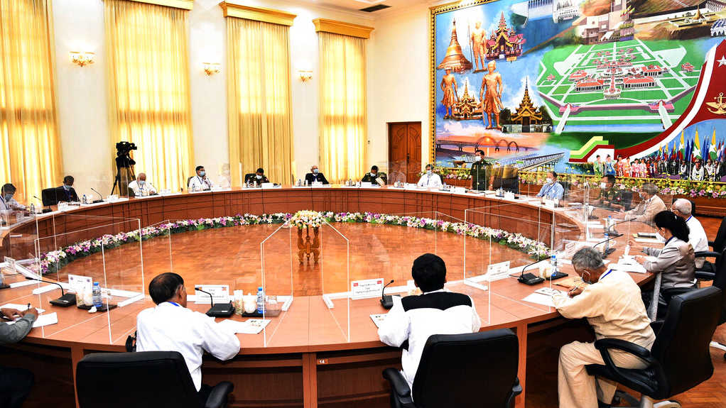 In this photo released by the Myanmar Military Information Team, Myanmar military chief Senior General Min Aung Hlaing addresses a meeting with representatives of political parties Friday, Aug. 14, 2020, in Naypyitaw, Myanmar.