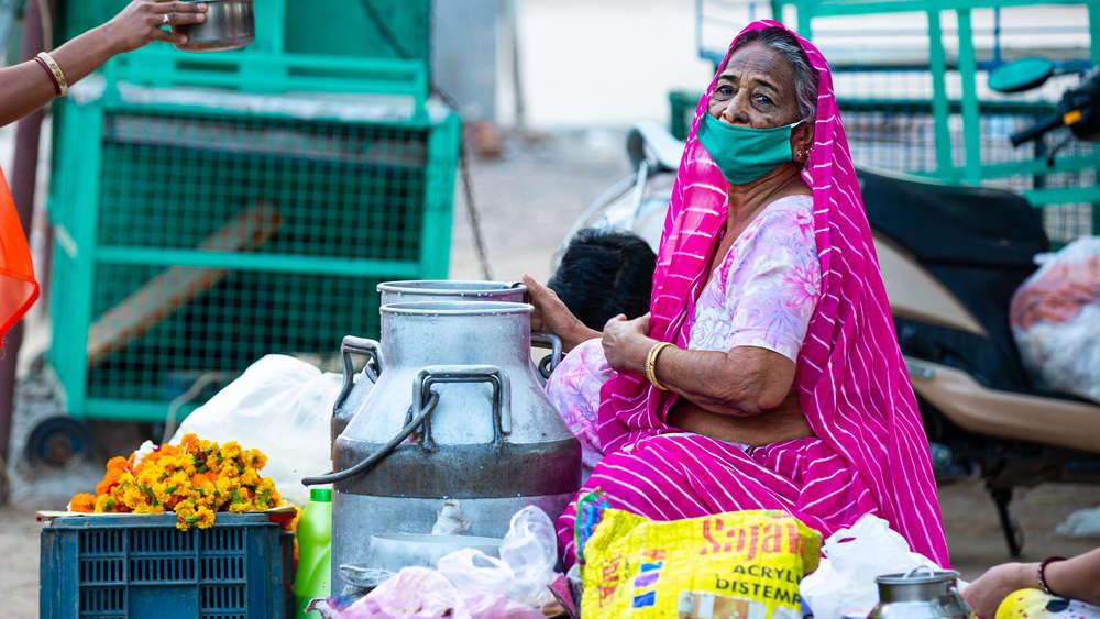 Old woman selling food on road, Jodhpur, Rajasthan, 30 March 2020.