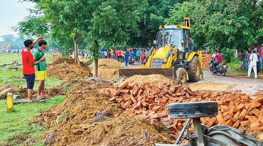 The boundary wall construction site on Pous Mela ground  in Santiniketan on Monday.