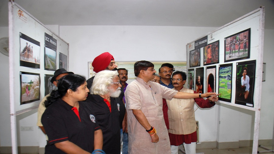 Visitors taking look during the Photography Competition cum Exhibition at CMPF Guest House in Dhanbad on the occasion of World Photography Day held last year