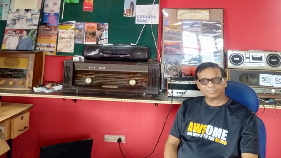 Chinmoy Mahto with his collection of radios in Jamshedpur on Thursday