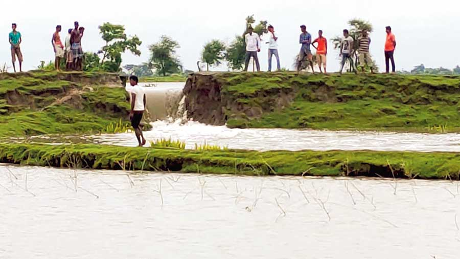 A damaged stretch of the earthen dam.