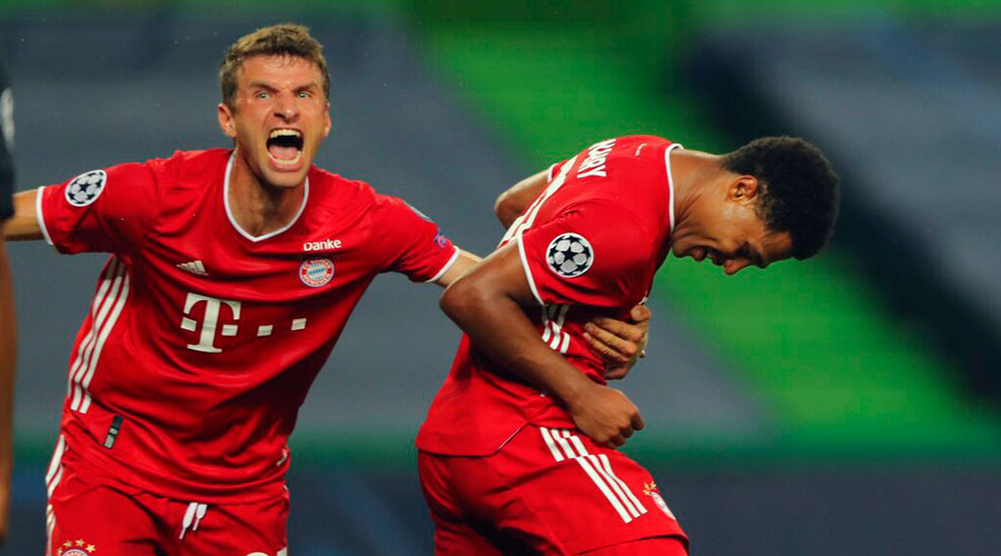 Bayern's Serge Gnabry (right) celebrates his side's second goal with his teammate Thomas Mueller during the Champions League semifinal against Lyon in Lisbon on Wednesday.