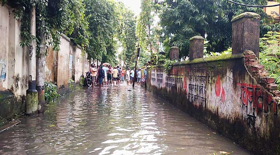 The waterlogged lane in Shibpur where the two men were electrocuted on Thursday.