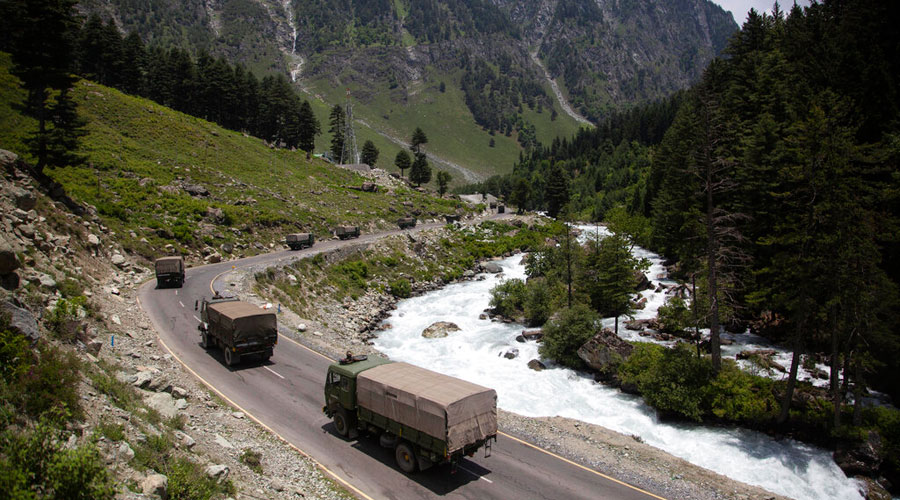 In this June 17, 2020, file photo, an Indian army convoy moves on the Srinagar- Ladakh highway at Gagangeer, north-east of Srinagar.