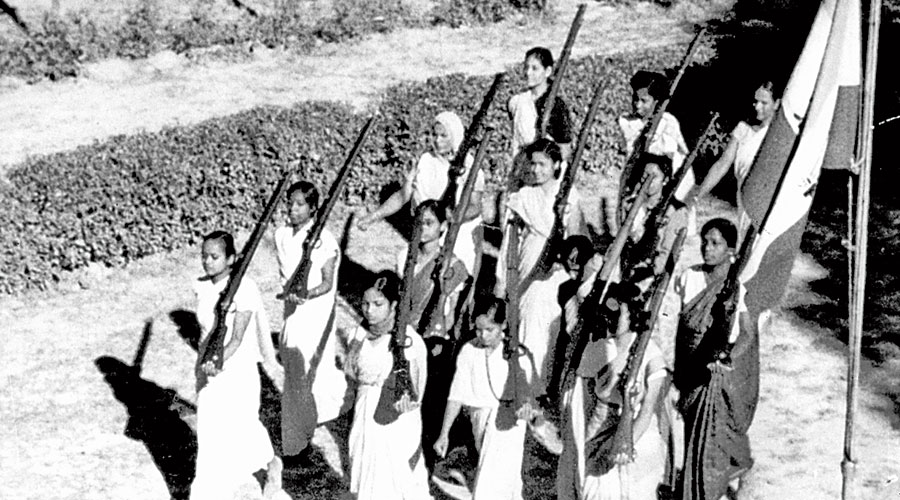 The women marching with rifles
