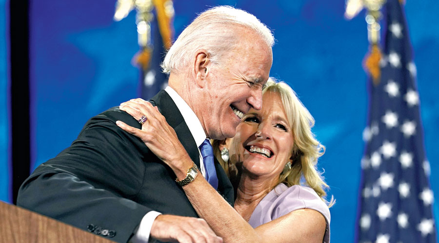Democratic presidential candidate Joe Biden hugs his wife Jill after his speech on the fourth day of the Democratic National Convention in Wilmington, Delaware.