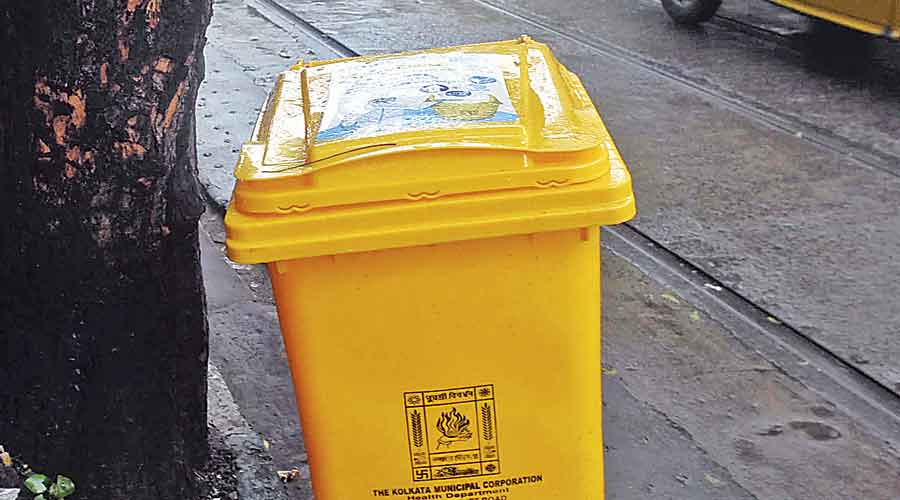A yellow bin on Aurobindo Sarani