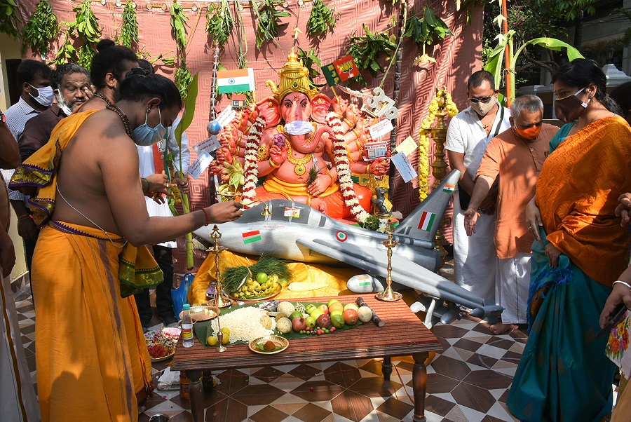 Priests and devotees offer prayers at the state BJP office in Chennai on Saturday.