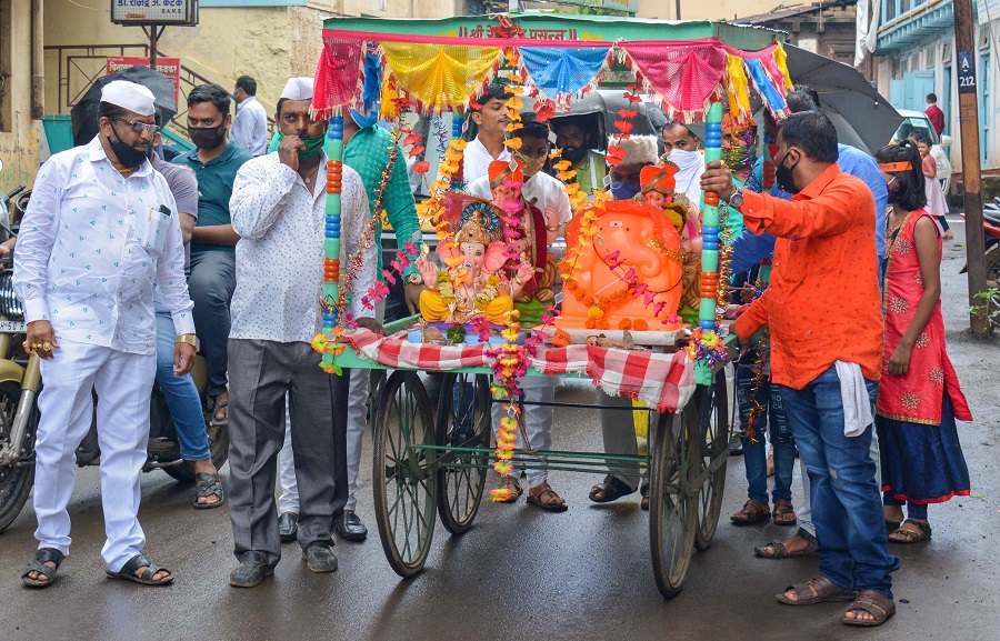 Devotees carry an idol of Lord Ganesha for installation on the occasion of Ganesh Chaturthi, in Karad on Friday.