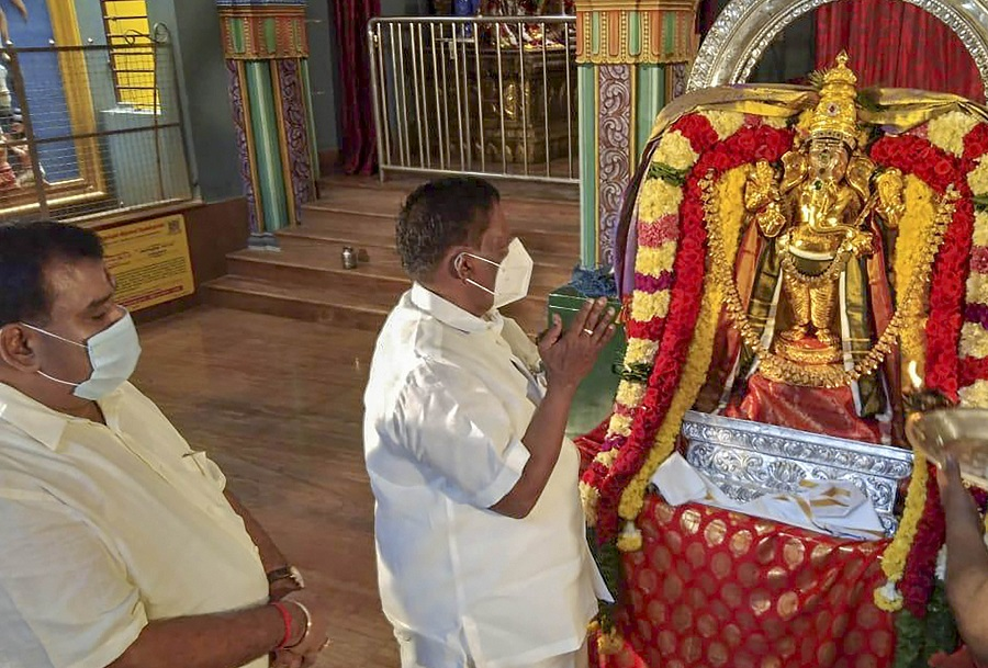 Puducherry Chief Minister V Narayanasamy offers prayers at a Ganesha temple on Saturday.