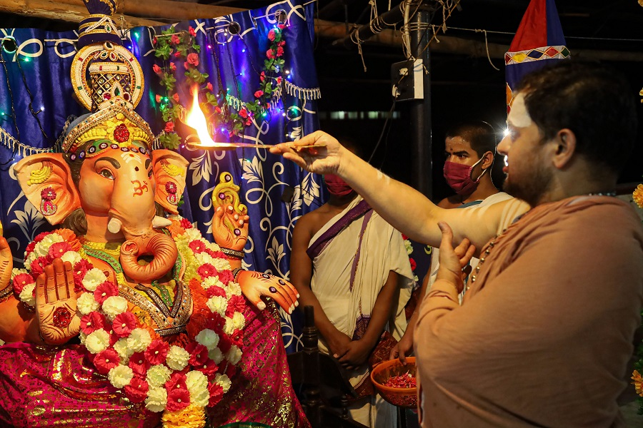 A priest performs aarti in front of an idol of Lord Ganesh, at Thali Sree Maha Ganapathi Balasubramanya Temple in Kozhikode on Friday.