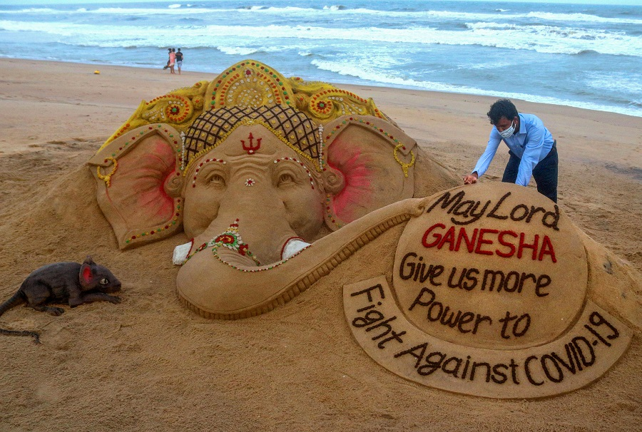 Sand artist Sudarsan Pattnaik creates a sand sculpture on the occasion of Ganesh Chaturthi, at Puri beach in Odisha on Friday.