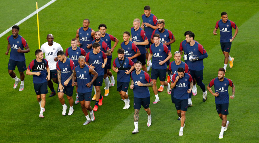 PSG players run during a training session at the Luz stadium in Lisbon on Saturday.