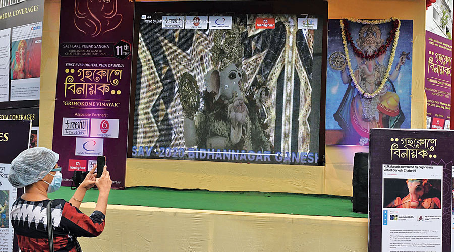 Ganesh Puja being streamed live to an LED screen on a stage erected near the PNB roundabout in Salt Lake on Saturday.