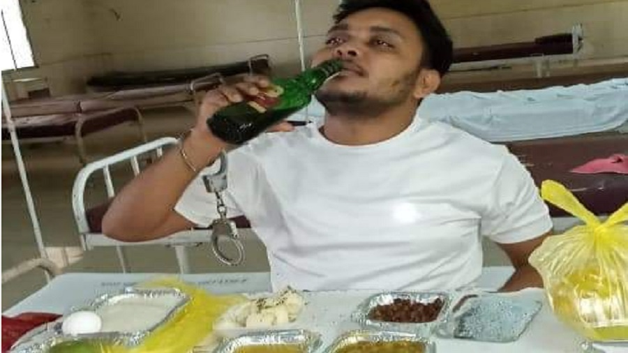 One of the photographs that went viral showing a prisoner drinking from what appears to be a liquor bottle at the Dedicated Covid Hospital in Dhanbad on Saturday