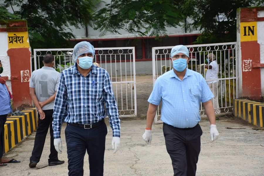 Dhanbad SDO Raj Maheshwaram (left) and Dy SP (law and order) Mukesh Kumar leave the dedicated Covid hospital after an inspection on Monday