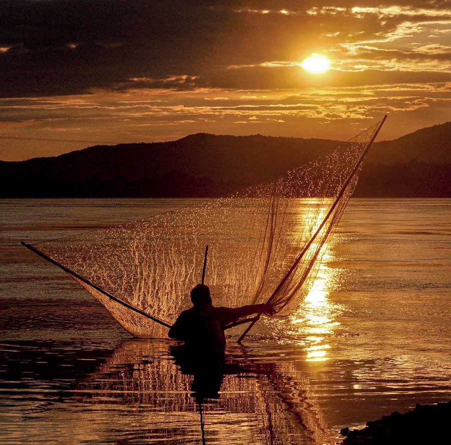 A fisherman casts his net in the Brahmaputra river in Guwahati on  Sunday.