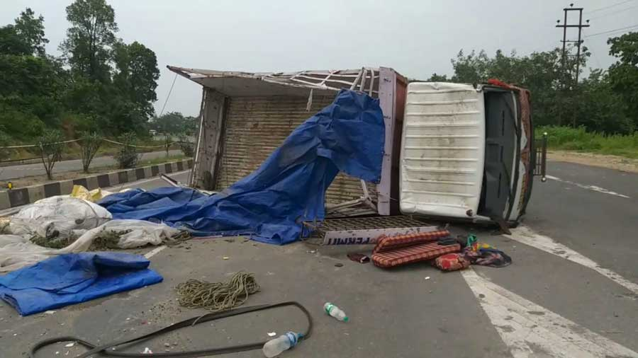 The mini truck which overturned after being hit by a speeding truck in Ramgarh on Sunday.