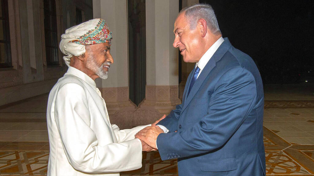 In this Oct. 26, 2018, photo released by Oman News Agency, Oman's Sultan Qaboos, left, greets Israeli Prime Minister Benjamin Netanyahu in Muscat, Oman.
