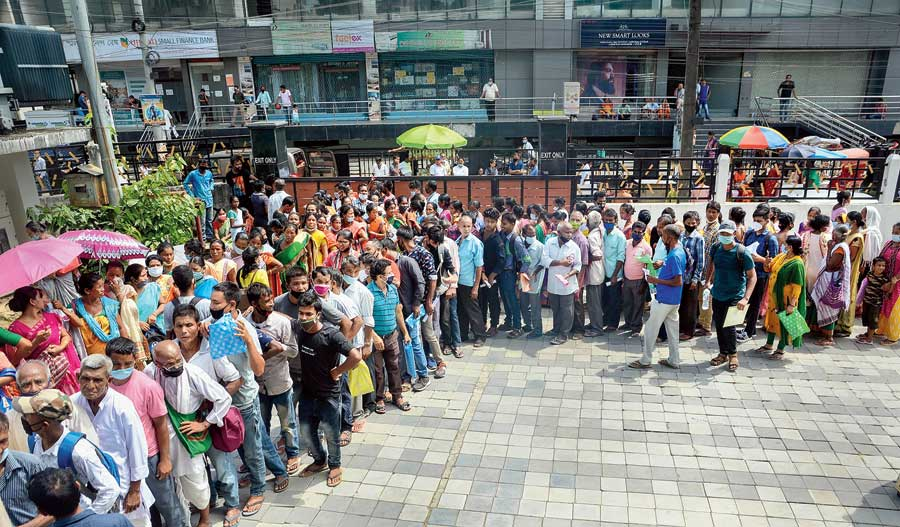 Social distancing norms being flouted in a queue for Aadhaar card registration  in Guwahati on Monday.