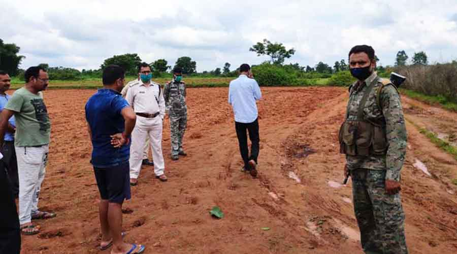 Police on the spot where dead body of Nikki Pandey was found in Hazaribagh on Monday.