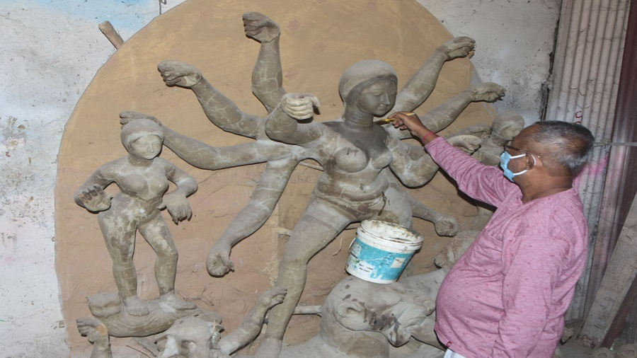 Dulal Paul, a sculptor making an idol of Goddess Durga at his workshop in Dhanbad on Wednesday.