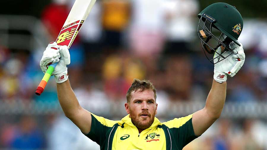 Aaron Finch celebrates after scoring a century against India during an ODI in Canberra on January 20, 2016.