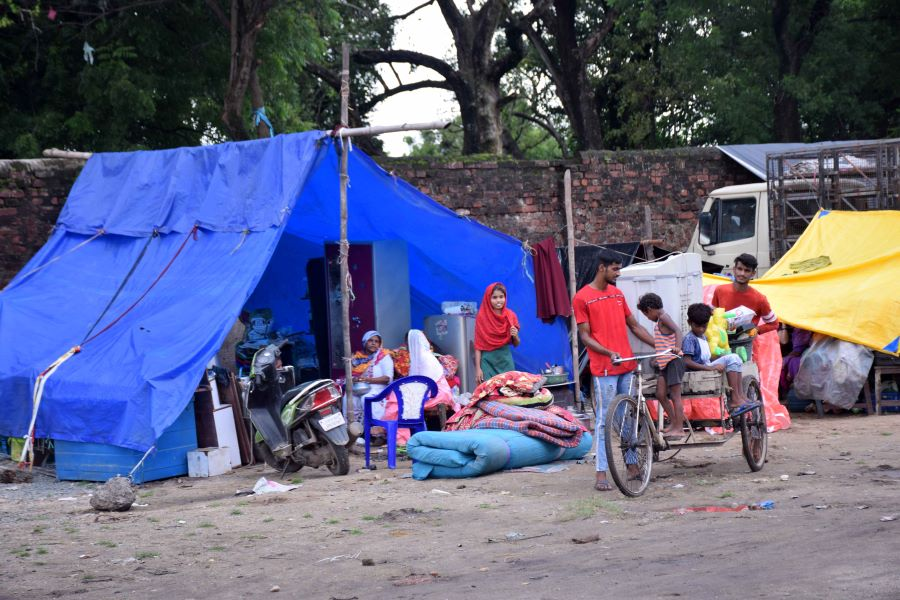Residents moved to a makeshift tent at Jugsalai after flash floods inundated their homes in Jamshedpur on Thursday