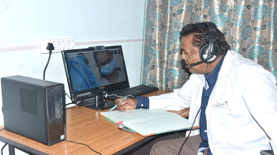 A doctor interacts with a Covid patient from the telemedicine studio after it was inaugurated at Circuit House in Dhanbad on Thursday