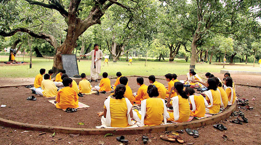 Students at an Open Air class inside Visva-Bharati University campus on the Teachers' Day at Santiniketan.