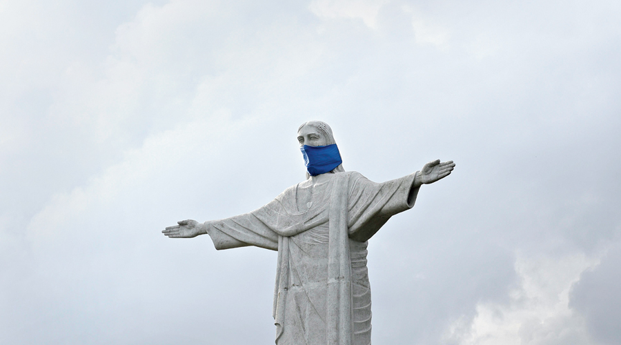 Mask must: A replica of Brazil's Christ The Redeemer, in a mask, at Eco Park, Calcutta
