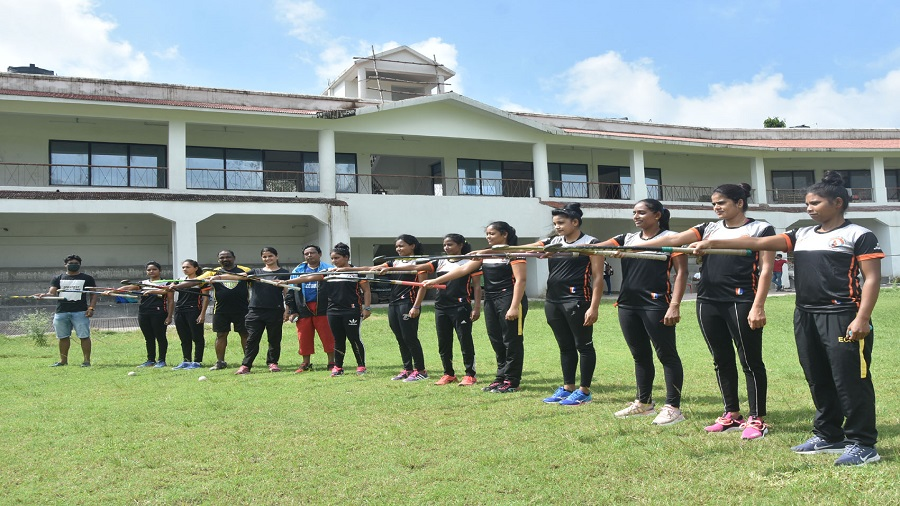 Women hockey players and coaches of East Central Railway (ECR) Zonal team and their coaches saluting to Major Dhyan Chand, the magician of hockey on his 115th birth anniversary, during the National Sports Day celebrations at Railway Stadium in Dhanbad  on Saturday