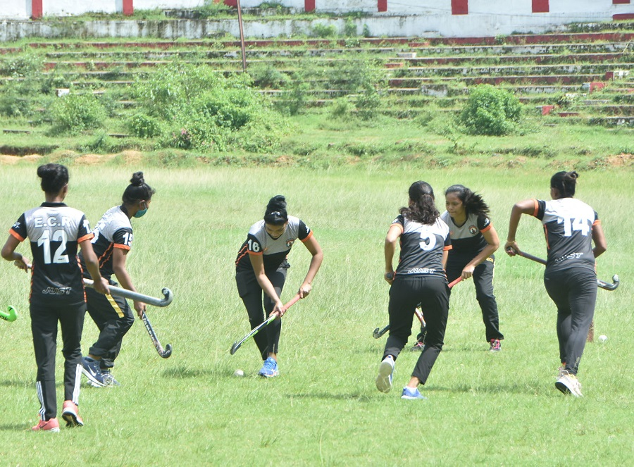 Women hockey players and coaches of East Central Railway (ECR) Zonal team at Railway Stadium in Dhanbad, during today's National Sports Day celebrations in Dhanbad on Saturday