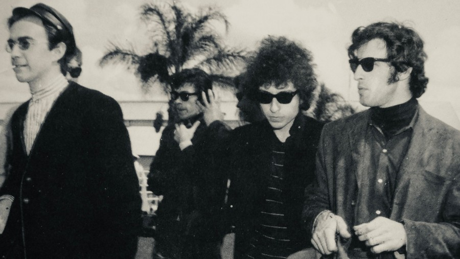 Early in the 1966 tour in Brisbane, Australia, Richard Alderson (extreme left) with Bob Dylan, flanked by Robbie Robertson and Richard Manuel of The Band.