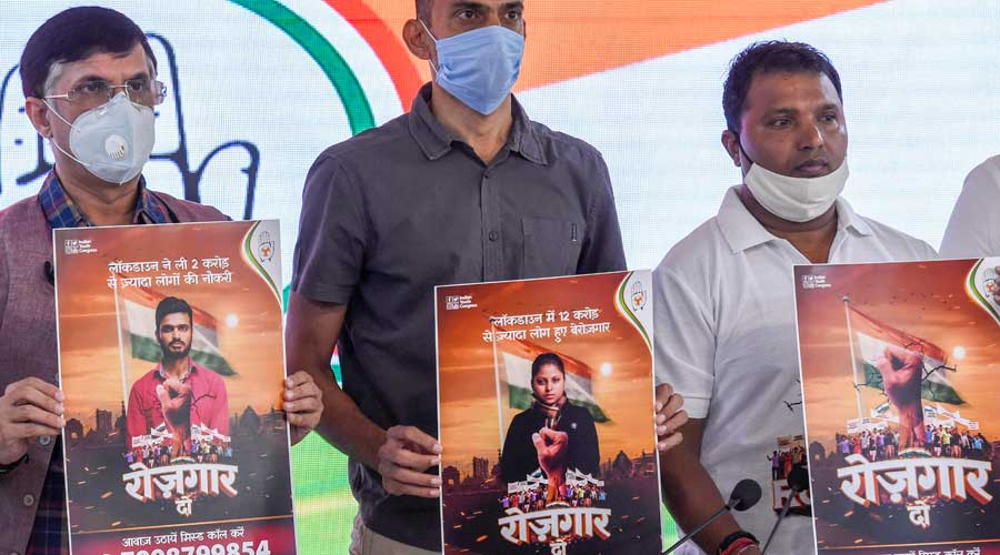 Congress leaders release posters of the 'Rozgar Do' campaign at the AICC headquarters in New Delhi on Saturday.