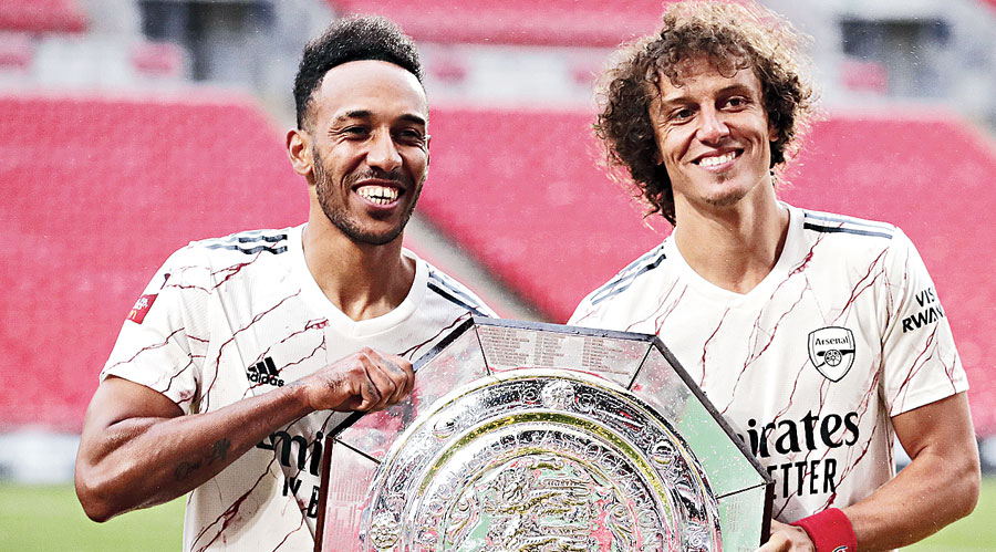 Pierre-Emerick Aubameyang (left) and David Luiz with the Community Shield on Saturday.