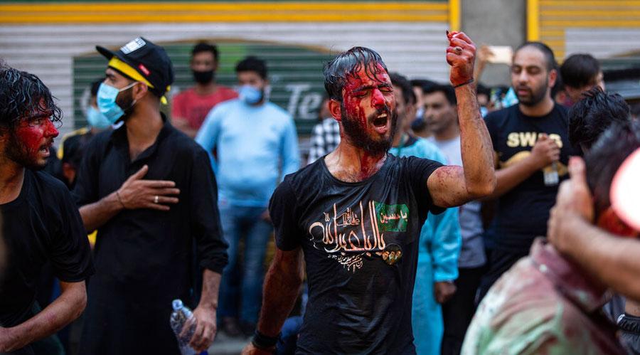 Blood runs down the face of a Kashmiri Shiite Muslims flagellating himself during a Muharram procession in Srinagar on Saturday.
