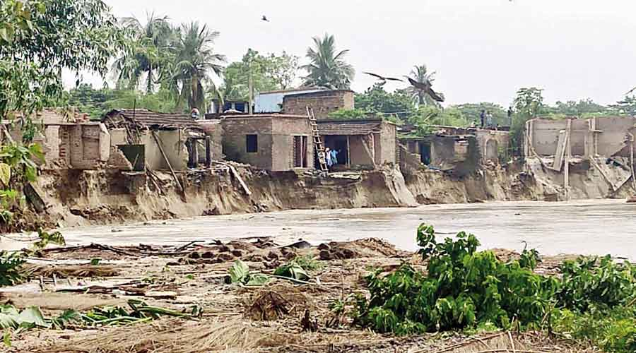 Ganga erodes land and homes at a village in Malda on Sunday morning