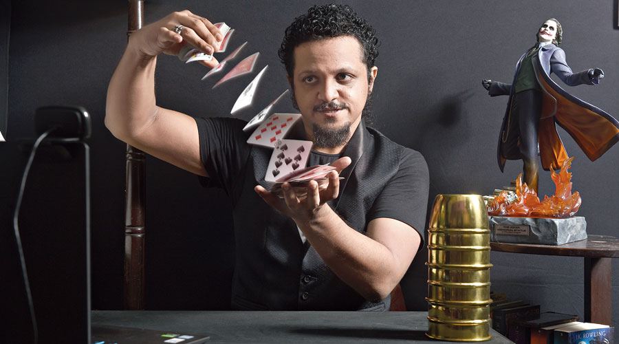 Amazing David performs a card trick in his studio.
