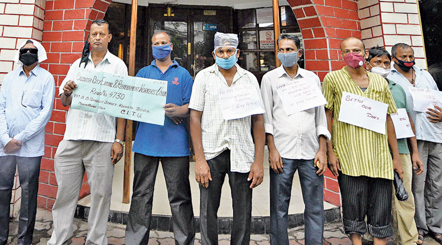 Employees of a restaurant in Calcutta protest after losing their jobs during the lockdown.
