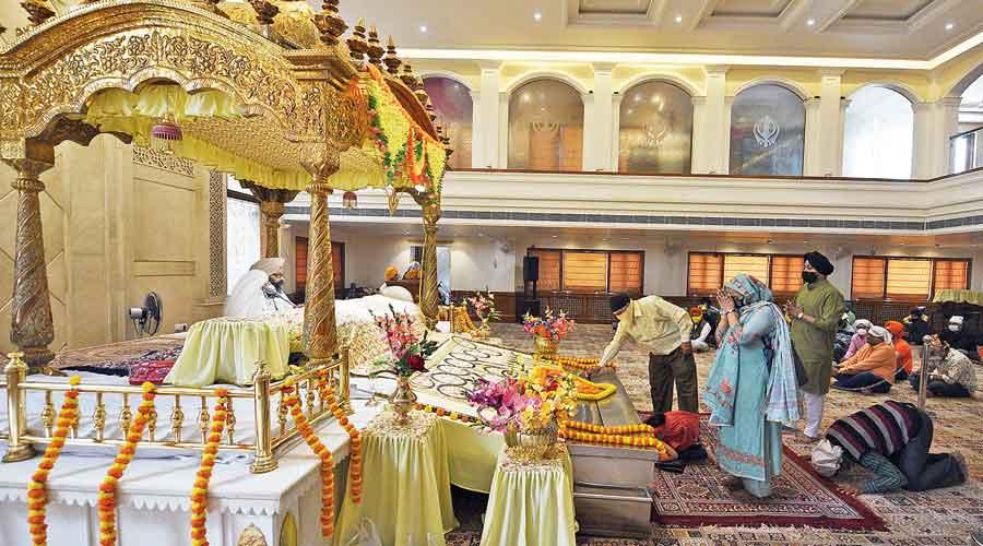 Devotees at Gurudwara Bara Sikh Sangat in Burrabazar on Monday
