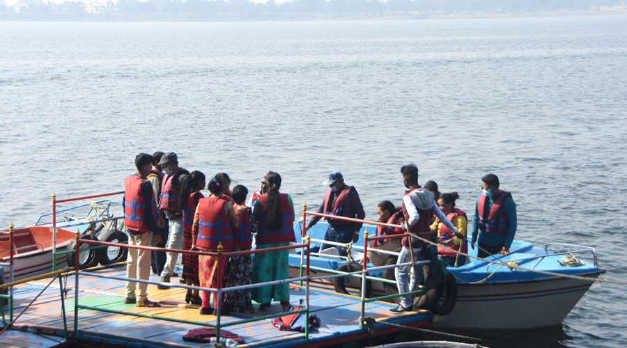 Tourists at the boating ghat at Maithon reservoir in Maithon, Dhanbad on Tuesday.