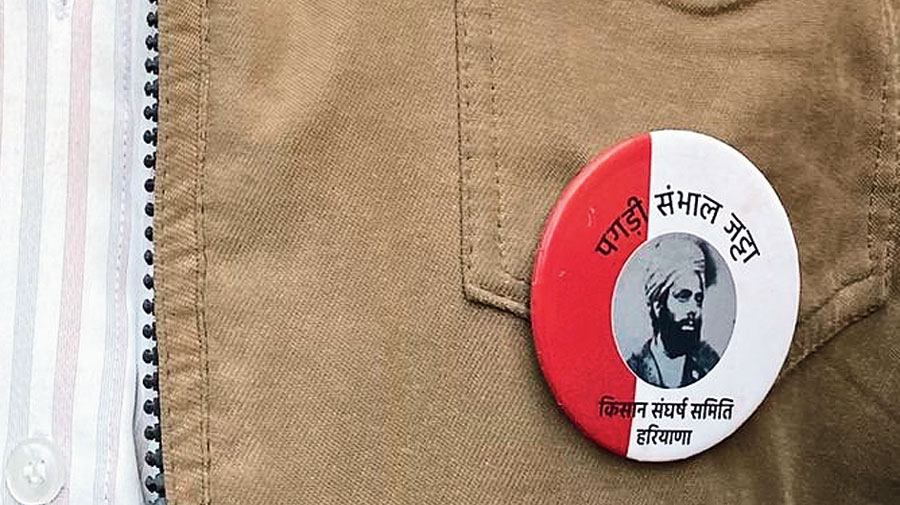 A member of the Kisan Sangharsh Samiti, Haryana, at the Delhi-Haryana Tikri Kalan border sports a badge with an image of Sardar Ajit Singh.